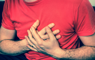 a man with chest pain & symptoms of a heart attack